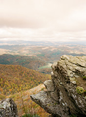 Rocky outcrop with dramatic scenic backdrop