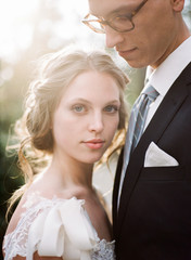 Bride and groom close together, portrait