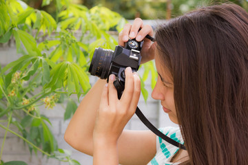 teen on nature with old camera