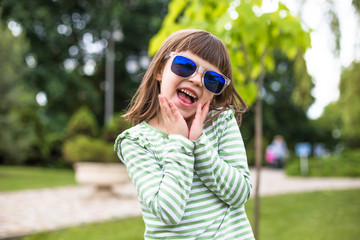 Happy child playing in city park. Summer sunny picture