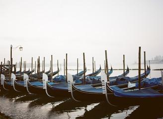 Gondolas moored in a row at dock