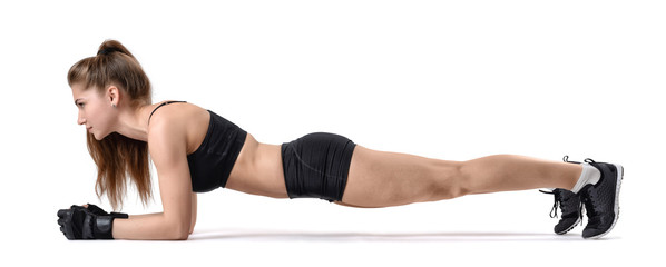 Cut-out fitness girl while during exercise plank