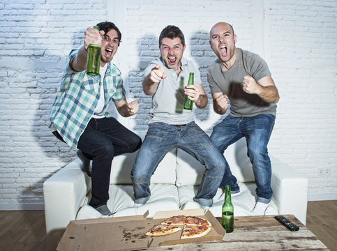 friends fanatic football fans watching game on tv celebrating go