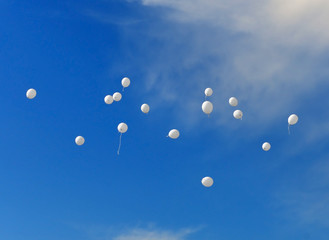 Abstract background. White balloons in the sky.