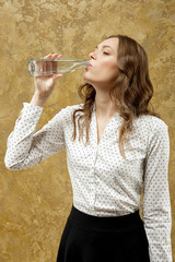 attractive girl with bottle of water in hand