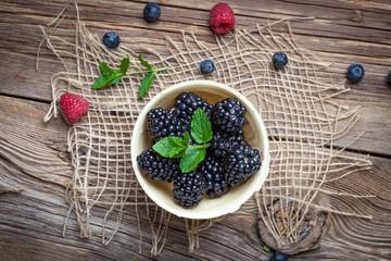 Blackberries in a waffle bowls.