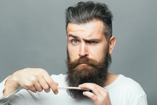 Bearded man with hair brush