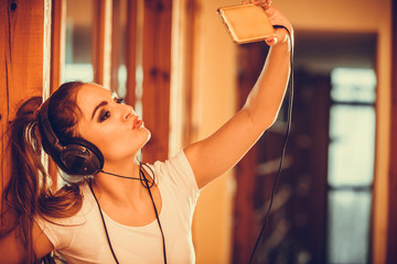 Woman with headphones smartphone listening music.