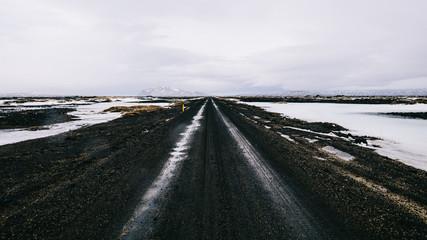 Car tracks on volcanic landscape