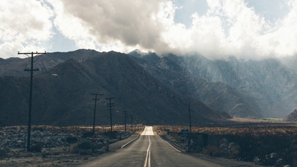 Diminishing perspective of road to mountains