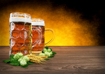 two oktoberfest glasses of beer with barley and hops - 3D render