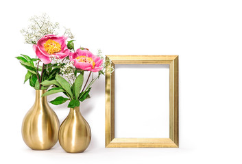 Golden picture frame pink flowers. Minimal decoration