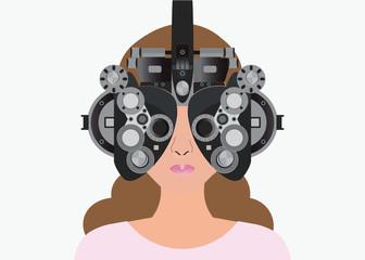 Woman looking through phoropter during eye exam.
