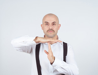 bald man showing time out hands gesture