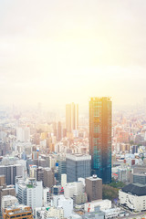 Business concept for real estate and corporate construction - panoramic modern city skyline bird eye aerial view with dramatic sunrise and morning sky in Osaka, Japan