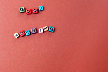 The words good morning spelled out in cube beads