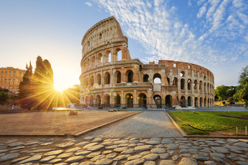 Colosseum in Rome and morning sun, Italy Fototapete
