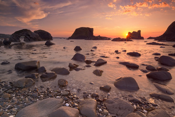 Sea stacks near Ballintoy Harbour in Northern Ireland at sunset