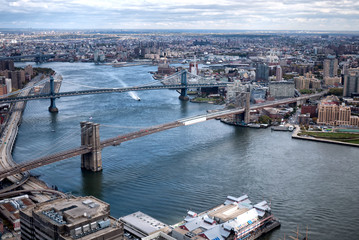 Aerial view East River, Manhattan, Brooklyn, and Queens in the distance
