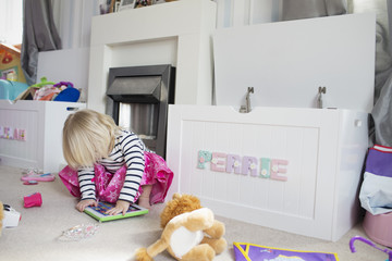 Portrait Of Young Girl Playing With Toys