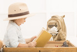 fab9a03c886fe ... hiding her face behind treasure map. alexandrum01 06-08-2016 Fotolia. Adorable  little girl in a safari hat and explorer clothes reading old book sitting  ...