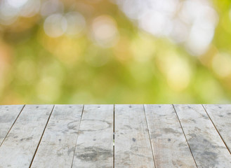 empty perspective grungy wood table top texture on blurred natur