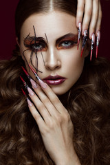 woman in the image of spider with creative art makeup and long nails. Manicure design, beauty face.