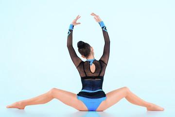 Aluminium Prints Gymnastics The girl doing gymnastics dance on a blue background