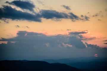 Sunset through stormy clouds over Vitosha mountain in Sofia, Bulgaria
