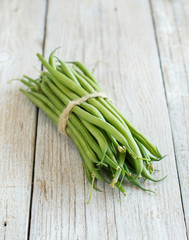Green french beans on wood
