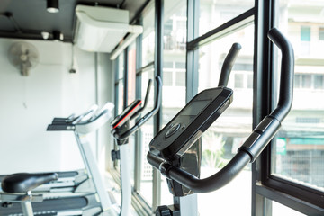 Exercise bikes in city gym fitness and health care concept