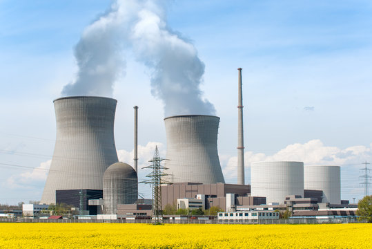Nuclear power Energy concept - Nuclear power plant with yellow f