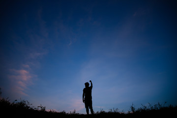Silhouette of man and beautiful sky.
