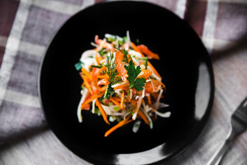 Vegetable salad of cabbage, carrot, cucumber and tomato, top view