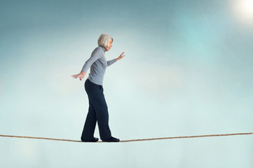 senior woman on a tightrope