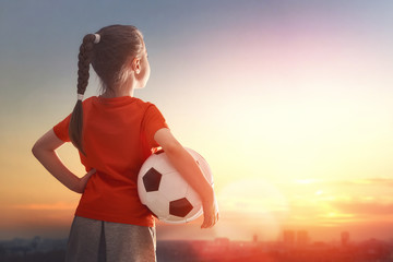 Child plays football.