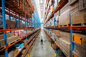 Warehouse manager standing in aisle