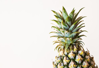 top of fresh pineapple on white background