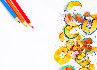 colored shavings and pencils on white