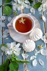 Composition with tea cup and flowers