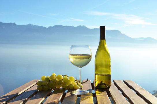 Wine against vineyards in Lavaux, Switzerland