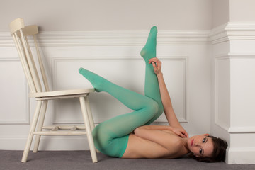 Cute Topless Woman in Green Tights