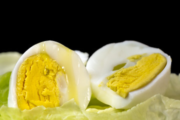 Drop of Extra Virgin olive oil over the yolk of a hard boiled egg cut in half