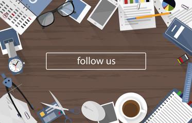 follow us on office desk