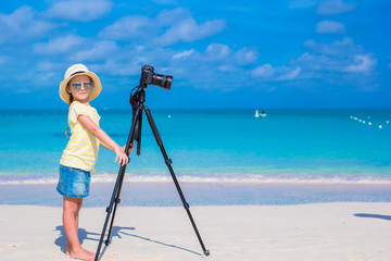 Little girl making video or photo with mobile phone