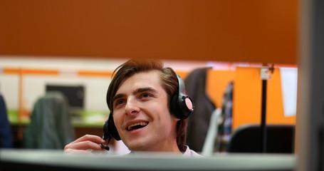 Portrait of confident male customer service representative with