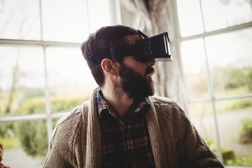 Profile view of hipster man using smart glasses