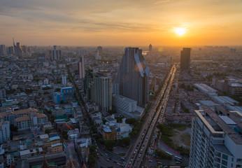 Sunset flare along the city of Bangkok, Thailand