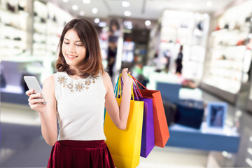 smiling young woman with happiness, credit card ,sale and people concept and shopping bags over mall background