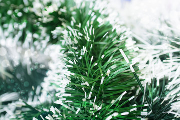 Natural background of Christmas tinsel with different blur the f